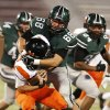 Norman North\'s Evan Coles (68) sacks Norman High School Tiger quarterback Zach Long (16) as the Timberwolves play the Tigers at Gaylord Family/Oklahoma Memorial Stadium in high school football on Thursday, Aug. 30, 2012 in Norman, Okla. Photo by Steve Sisney, The Oklahoman