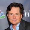 "Photo - In this Sept. 16, 2013 file photo, actor Michael J. Fox attends the NBC 2013 Fall season launch party hosted by Vanity Fair at Le Bain, in New York. The Nielsen company said Friday, Sept. 27, 2013, that Robin Williams' new CBS comedy, ""The Crazy Ones,"" debuted before 15.6 million people on Thursday night. It competed directly at 9 p.m. Eastern with ""The Michael J. Fox"" on NBC, which was seen by 7.2 million people. (Photo by Evan Agostini/Invision/AP)"