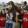 Michael Liebhart makes a hit with school children as Brodd the Troll during Medieval Fair on Friday, March 30, 2012, in Norman, Okla. Photo by Steve Sisney, The Oklahoman