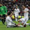 Real Madrid\'s Cristiano Ronaldo from Portugal, second left, celebrates his goal with Mesut Ozil from Germany, right, during a Spanish La Liga soccer match against Getafe at the Santiago Bernabeu stadium in Madrid, Spain, Sunday, Jan. 27, 2013. (AP Photo/Andres Kudacki)
