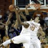 Coppin State\'s Charles Ieans (34) is defended by Texas\' Prince Ibeh, center, and Ioannis Papapetrou (33) during the second half of an NCAA college basketball game, Monday, Nov. 12, 2012, in Austin, Texas. Texas won 69-46. (AP Photo/Eric Gay)