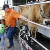 Ralph Keel gets a hug from first-grader Lejend Collins after a milking demonstration during the Southwest Dairy Farmers mobile classroom at Coolidge Elementary School, Friday, March 6, 2009. Photo By David McDaniel, The Oklahoman