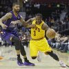 Photo - Cleveland Cavaliers' Dion Waiters (3) loses the ball under pressure from Phoenix Suns' Markieff Morris in the second quarter of an NBA basketball game, Sunday, Jan. 26, 2014, in Cleveland. (AP Photo/Mark Duncan)