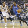 Oklahoma City\'s Kevin Durant (35) drives up court as Memphis\' Tayshaun Prince (21) defends during Game 6 in the first round of the NBA playoffs between the Oklahoma City Thunder and the Memphis Grizzlies at FedExForum in Memphis, Tenn., Thursday, May 1, 2014. Photo by Bryan Terry, The Oklahoman