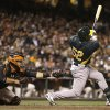 Photo - Oakland Athletics' Yoenis Cespedes swings for a two-run home run off San Francisco Giants' Tim Lincecum in the fourth inning of an exhibition baseball game Thursday, March 28, 2013, in San Francisco. (AP Photo/Ben Margot)