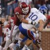 OU\'s Tom Wort (21) forces a fumble on KU\'s Dayne Crist (10) during the college football game between the University of Oklahoma Sooners (OU) and the University of Kansas Jayhawks (KU) at Gaylord Family-Oklahoma Memorial Stadium on Saturday, Oct. 20th, 2012, in Norman, Okla. Photo by Chris Landsberger, The Oklahoman