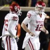 Oklahoma\'s Landry Jones (12) and Oklahoma\'s Ryan Broyles (85) celebrate after a touchdown during the Bedlam college football game between the University of Oklahoma Sooners (OU) and the Oklahoma State University Cowboys (OSU) at Boone Pickens Stadium in Stillwater, Okla., Saturday, Nov. 27, 2010. Photo by Bryan Terry, The Oklahoman