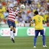 Photo -   United States' forward Landon Donovan (10) battles for the ball against Brazil's Thiago Silva (3) during the first half of an international friendly soccer game on Wednesday, May 30, 2012, in Landover, Md. (AP Photo/Nick Wass)