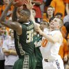 South Florida Bulls\' Toarlyn Fitzpatrick (32) and Oklahoma State \'s Phil Forte (10) go after a loose ball during the college basketball game between Oklahoma State University (OSU) and the University of South Florida (USF) on Wednesday , Dec. 5, 2012, in Stillwater, Okla. Photo by Chris Landsberger, The Oklahoman