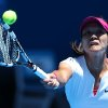Photo - Li Na of China makes a forehand return to Ana Konjuh of Croatia during their first round match at the Australian Open tennis championship in Melbourne, Australia, Monday, Jan. 13, 2014.(AP Photo/Rick Rycroft)