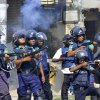 Bangladeshi policemen disperse protesters in Rajshahi, Bangladesh, Friday, March 1, 2013. Protesters clashed with police for a second day Friday as the death toll rose to at least 44 in clashes triggered by a death sentence given to Delwar Hossain Sayedee, one of the top leaders of the country\'s largest Islamic party Jamaat-e-Islami, for crimes linked to Bangladesh\'s 1971 independence war, police said. (AP Photo)