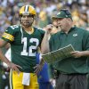 Green Bay Packers quarterback Aaron Rodgers talks with coach Mike McCarthy during the second half of an NFL football game against the New Orleans Saints on Sunday, Sept. 30, 2012, in Green Bay, Wis. The Packers won 28-27. (AP Photo/Mike Roemer)