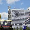 Photo - German national soccer  player Mesut Ozil  is visible  on the facade of a publisher's building at Alexanderplatz  square inBerlin, Germany, Friday June 6,  2014. Sportswear manufacturer Adidas has put up the advertisement on the entire facade of the building prior to the soccer WCup  tournament in Brazil. (AP Photo/dpa,Jens Kalaene)