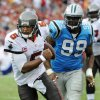 Photo -   Tampa Bay Buccaneers quarterback Josh Freeman (5) turns upfield away from Carolina Panthers defensive tackle Frank Kearse (99) during the second quarter of an NFL football game, Sunday, Sept. 9, 2012, in Tampa, Fla. (AP Photo/Brian Blanco)