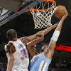 Denver\'s Nene (31) goes to the basket on Oklahoma City\'s Kevin Durant (35) during the first round NBA playoff game between the Oklahoma City Thunder and the Denver Nuggets on Sunday, April 17, 2011, in Oklahoma City, Okla. Photo by Chris Landsberger, The Oklahoman