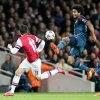 Photo - Arsenal's Mesut Ozil, left, and Bayern's Dante challenge for the ball during a Champions League, round of 16, first leg soccer match between Arsenal and Bayern Munich at the Emirates stadium in London, Wednesday, Feb. 19, 2014 .(AP Photo/Alastair Grant)
