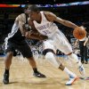 Oklahoma City\'s Kevin Durant (35) drives the ball against San Antonio\'s Kawhi Leonard (2) during the NBA basketball game between the Oklahoma City Thunder and the San Antonio Spurs at Chesapeake Energy Arena in Oklahoma City, Friday, March 16, 2012. Photo by Nate Billings, The Oklahoman