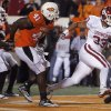 Oklahoma\'s Trey Millard (33) scores a touchdown in front of Oklahoma State\'s Orie Lemon (41) during the Bedlam college football game between the University of Oklahoma Sooners (OU) and the Oklahoma State University Cowboys (OSU) at Boone Pickens Stadium in Stillwater, Okla., Saturday, Nov. 27, 2010. Photo by Sarah Phipps, The Oklahoman