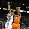 Oklahoma\'s Markel Brown (22) shoots over Missouri\'s Steve Moore (32) during the Big 12 tournament men\'s basketball game between the Oklahoma State Cowboys and Missouri Tigers the Sprint Center, Thursday, March 8, 2012. Photo by Sarah Phipps, The Oklahoman