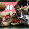 Photo - Milwaukee Bucks' Giannis Antetokounmpo, right, and Chicago Bulls' Mike Dunleavy go after a loose ball during the second half of an NBA basketball game Friday, Dec. 13, 2013, in Milwaukee. (AP Photo/Morry Gash)