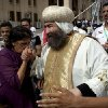 An Egyptian Coptic woman pays her respect for Anba Yuanis as he leaves following the papal election ceremony at the Coptic Cathedral in Cairo, Egypt, Sunday, Nov. 4, 2012. Egypt\'s ancient Coptic Christian church chose a new pope in an elaborate Sunday ceremony meant to invoke the will of God, in which a blindfolded boy drew the name of the next patriarch from a crystal chalice. Bishop Tawadros will be ordained Nov. 18 as Pope Tawadros II, the spiritual leader of a community that increasingly fears for its future amid the rise of Islamists to power in the wake of the 2011 ouster of longtime authoritarian leader Hosni Mubarak. (AP Photo/Nasser Nasser)