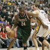 Photo - Milwaukee Bucks forward Desmond Mason, left, drives to the bucket past Indiana Pacers Mike Dunleavy in the first half of NBA basketball action in Indianapolis, Sunday, April 6, 2008.  (AP Photo/Michael Conroy) ORG XMIT: NAF102