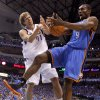 Oklahoma City\'s Serge Ibaka (9) fights for the ball with Dallas\' Dirk Nowitzki (41) during Game 3 of the first round in the NBA playoffs between the Oklahoma City Thunder and the Dallas Mavericks at American Airlines Center in Dallas, Thursday, May 3, 2012. Photo by Bryan Terry, The Oklahoman