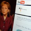 FILE- This Dec.31, 2008 file photo taken through a magnifying glass shows a video of German Chancellor Angela Merkel delivering her New Year\'s speech beside the Youtube channel of the German government. YouTube announced Monday, Oct. 8, 2012, that it is extending its original programming initiative into Europe, with at least 60 new video channels from media companies including Britain\'s BBC, London-based FreemantleMedia and the Netherlands\' Endemol. The Google Inc.-owned video site said Monday it is launching more than 60 new video channels with content from Britain, Germany, France, and the United States. (AP Photo/dapd, David Hecker, File)