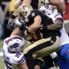 Photo - New Orleans Saints quarterback Drew Brees (9) is sacked by Buffalo Bills defensive tackle Kyle Williams (95) and strong safety Da'Norris Searcy 2during the first half of an NFL football game in New Orleans, Sunday, Oct. 27, 2013. (AP Photo/Bill Feig)