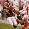 Oklahoma\'s Ryan Broyles (85) is drug down by Nebraska\'s Eric Hagg (28) during the first half of the college football game between the University of Oklahoma Sooners (OU) and the University of Nebraska Huskers (NU) at the Gaylord Family Memorial Stadium, on Saturday, Nov. 1, 2008, in Norman, Okla. BY STEVE SISNEY, THE OKLAHOMAN