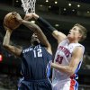 Photo -   Detroit Pistons forward Jonas Jerebko (33), of Sweden, tries to defend against a shot by Charlotte Bobcats forward Tyrus Thomas (12) during the first half of an NBA preseason basketball game Saturday, Oct. 20, 2012, in Auburn Hills, Mich. (AP Photo/Duane Burleson)