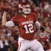 Oklahoma\'s Landry Jones (12) throws the ball during the college football game between the University of Oklahoma Sooners (OU) and Texas Tech University Red Raiders (TTU) at the Gaylord Family-Oklahoma Memorial Stadium on Sunday, Oct. 23, 2011. in Norman, Okla. Photo by Chris Landsberger, The Oklahoman