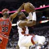 Photo - Miami Heat's Dwyane Wade, right, shoots as Chicago Bulls' Richard Hamilton (32) defends during the first half of Game 5 of an NBA basketball Eastern Conference semifinal, Wednesday, May 15, 2013, in Miami. (AP Photo/Wilfredo Lee)