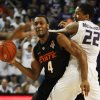Oklahoma State guard Brian Williams (4) looks to pass while covered by Kansas State guard Rodney McGruder (22) during the first half of an NCAA college basketball game Saturday, March 3, 2012, in Manhattan, Kan. (AP Photo/Orlin Wagner) ORG XMIT: KSOW103