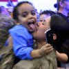 SPC Yuseli Freire kisses her son Yuni during the return ceremony for the National Guard\'s 45th Infantry Brigade Combat Team at the Army Aviation hanger at Will Rogers Air National Guard Base Sunday, March 25th, 2012. PHOTO BY HUGH SCOTT, FOR THE OKLAHOMAN