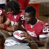 Running back Damien Williams signs autographs during fan appreciation day for the University of Oklahoma Sooner (OU) football team at Gaylord Family-Oklahoma Memorial Stadium in Norman, Okla., on Saturday, Aug. 3, 2013. Photo by Steve Sisney, The Oklahoman