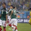 Photo - Mexico's Giovani dos Santos  reacts after his goal was disallowed during the group A World Cup soccer match between Mexico and Cameroon in the Arena das Dunas in Natal, Brazil, Friday, June 13, 2014. (AP Photo/Ricardo Mazalan)