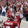 Oklahoma Trevor Knight and Jalen Saunders celebrate after Knight\'s touchdown against Iowa State in the third quarter of an NCAA college football game in Norman, Okla. on Saturday, Nov. 16, 2013. Oklahoma won 48-10. (AP Photo/Alonzo Adams)
