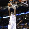 Oklahoma City\'s Kevin Durant (35) dunks in front of Charlotte\'s Anthony Tolliver (43) during the NBA basketball game between the Oklahoma City Thunder and the Charlotte Bobcats at the Chesapeake Energy Arena, Sunday, March 2, 2014. Photo by Sarah Phipps, The Oklahoman
