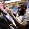 Photo - Oklahoma City's James Harden signs autographs before Game 2 of the first round in the NBA playoffs between the Oklahoma City Thunder and the Dallas Mavericks at Chesapeake Energy Arena in Oklahoma City, Monday, April 30, 2012. Photo by Nate Billings, The Oklahoman