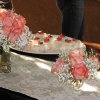 MEET ROSE....Pink roses and baby\'s breath decorated the table. (Photo by Helen Ford Wallace).