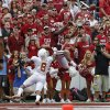 OU\'s Justin Brown (19) catches a touchdown pass beside UT\'s Quandre Diggs (6) during the Red River Rivalry college football game between the University of Oklahoma (OU) and the University of Texas (UT) at the Cotton Bowl in Dallas, Saturday, Oct. 13, 2012. Oklahoma won 63-21. Photo by Bryan Terry, The Oklahoman