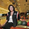 In this Thursday, Oct. 25, 2012 photo, owner Peppe Smith poses for a photo in her bowling alley in Boardman, Ohio. Smith sees positive signs all around her suburban Youngstown community.
