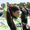 Photo -   Driver Danica Patrick fixes her hair after qualifying for the NASCAR Nationwide series Sargento 200 auto race at Road America in Elkhart Lake, Wis., Saturday, June, 23, 2012. (AP Photo/Jeffrey Phelps)
