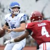 Photo - Indiana State quarterback Mike Perish (15) tries to get the pass off under pressure from Indiana linebacker Forisse Hardin (4) during an NCAA college football game at Memorial Stadium in Bloomington, Ind., Saturday, Aug. 30, 2014. (AP Photo/The Herald-Times, Chris Howell)
