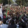 Pakistan\'s ex-cricket star-turned-politician Imran Khan, top left, addresses supporters during a peace march in Mianwali, Pakistan, Saturday, Oct. 6, 2012. Thousands of Pakistanis joined by a group of U.S. anti-war activists headed toward Pakistan\'s militant-riddled tribal belt Saturday to protest U.S. drone strikes - even as a Pakistani Taliban faction warned that suicide bombers would stop the demonstration. (AP Photo/Jabbar Ahmed)