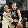 Photo - Connecticut's Kelly Faris, left, pressures Idaho's Connie Ballestero, right, in the first half of a first-round game in the women's NCAA college basketball tournament in Storrs, Conn., Saturday, March 23, 2013. (AP Photo/Jessica Hill)