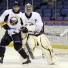 Buffalo Sabres\' Mikhail Grigorenko, of Russia, gets bumped by goalie Ryan Miller in front of the crease during the first day of NHL hockey training camp in Buffalo, New York, Sunday, Jan. 13, 2013. (AP Photo/Gary Wiepert)