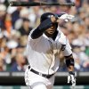 Detroit Tigers\' Alex Gonzalez tosses his bat after lining a single driving in the winning run during the ninth inning of a baseball game against the Kansas City Royals in Detroit, Monday, March 31, 2014. (AP Photo/Carlos Osorio)