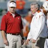 The football programs of OU\'s Bob Stoops, left, and Texas\' Mack Brown have risen together since the schools joined the Big 12 Conference. Photo by Nate Billings, The Oklahoman